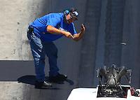 Jun 18, 2016; Bristol, TN, USA; Crew member for NHRA pro mod driver Chip King during qualifying for the Thunder Valley Nationals at Bristol Dragway. Mandatory Credit: Mark J. Rebilas-USA TODAY Sports