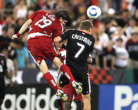 Adam Cristman #7 of D.C. United loses a header to Zach Loyd #19 of FC Dallas during an MLS match at RFK Stadium in Washington D.C. on August 14 2010. Dallas won 3-1.