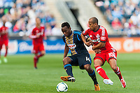 Amobi Okugo (14) of the Philadelphia Union shields the ball from Robert Earnshaw (10) of Toronto FC during a Major League Soccer (MLS) match at PPL Park in Chester, PA, on April13, 2013.