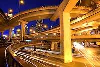 Car traffic passes by elevated highways at dusk in Shanghai, China, on July 26, 2007. Photo by Lucas Schifres/Pictobank
