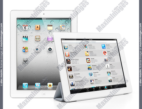 Two Apple iPad 2 tablet computers desktop and app store on their displays. Isolated on white background.