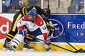 Carson Grolla (AIC - 25), Joseph Pendenza (UML - 14) - The University of Massachusetts Lowell River Hawks defeated the visiting American International College Yellow Jackets 6-1 on Tuesday, December 3, 2013, at Tsongas Arena in Lowell, Massachusetts.