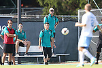 02 September 2013: Coastal Carolina head coach Shaun Docking (standing on bench) and assistant Kyle Russell (center) watch first half action. The University of North Carolina Tar Heels hosted the Coastal Carolina University Chanticleers at Fetzer Field in Chapel Hill, NC in a 2013 NCAA Division I Men's Soccer match. UNC won the game 4-0.