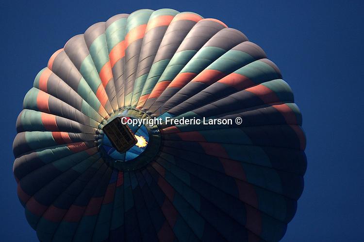 Hot air balloon sails over Napa Valley, California.