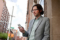 Josh Williams, co-founder and CEO of Gowalla, a location-based social media service, poses with his smartphone for the photographer in New York, USA, 20 April 2010.