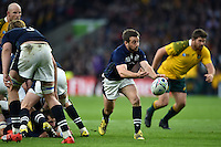 Greig Laidlaw of Scotland passes the ball. Rugby World Cup Quarter Final between Australia and Scotland on October 18, 2015 at Twickenham Stadium in London, England. Photo by: Patrick Khachfe / Onside Images