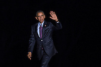 United States President Barack Obama waves as he walks on the South Lawn towards the White House after arriving on Marine One in Washington, D.C., U.S., on Tuesday, October 25, 2016. President Obama is returning from a campaign and fundraising trip to California. <br /> Credit: Andrew Harrer / Pool via CNP /MediaPunch