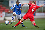St Johnstone v Ross County...17.11.12      SPL.Gregory Tade skips a tackle from Grant Munro.Picture by Graeme Hart..Copyright Perthshire Picture Agency.Tel: 01738 623350  Mobile: 07990 594431