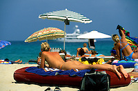 Young sunbathers on Tahiti Beach at St. Tropez,  C&ocirc;te d'Azur, the French Riviera - Photograph by Owen Franken
