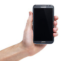 Hand holding Samsung Galaxy Note II smartphone Android phone isolated on white background