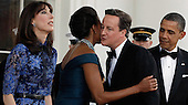 (L-R) Samantha Cameron, First lady Michelle Obama, British Prime Minister David Cameron and U.S. President Barack Obama greet one another on the North Portico of the White House March 14, 2012 in Washington, DC. Cameron is on a three-day visit to the U.S. and he was expected to have talks with Obama on the situations in Afghanistan, Syria and Iran..Credit: Chip Somodevilla / Pool via CNP