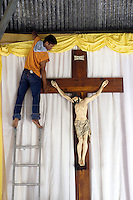 April 9th, 2004-Balibo, Timor-Leste- Workers prepare a large crucifix for an Easter procession in the town of Balibo in Bobonaro District.  The annual Easter event in Balibo comprises a strange mix of Catholic and ancient traditions. Photograph by Daniel J. Groshong/Tayo Photo Group