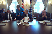 During a meeting with his National Security Council (NSC) in the Cabinet Room, United States President George W. Bush talks with Counselor Karen Hughes, Wednesday, September 12, 2001. Seated with the President are, from left to right, U.S. Secretary of State Colin Powell, U.S. Vice President Dick Cheney..Mandatory Credit: Eric Draper - White House via CNP.