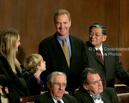 Washington, D.C. - January 4, 2007 --  United States Representative Chris Van Hollen (Democrat of the 8th District of Maryland), Chairman of the Democratic Congressional Campaign Committee (DCCC) watches the voting for U.S.  Representative Nancy Pelosi (Democrat of the 8th District of California) as the Speaker of the United States House of Representatives in the Capitol in Washington, D.C. on Thursday, January 4, 2007.  Speaker Pelosi is the first woman in U.S. history to serve in that position.  With Van Hollen are his children at left and former U.S. Secretary of Transportation Norman Y. Mineta..Credit: Ron Sachs / CNP
