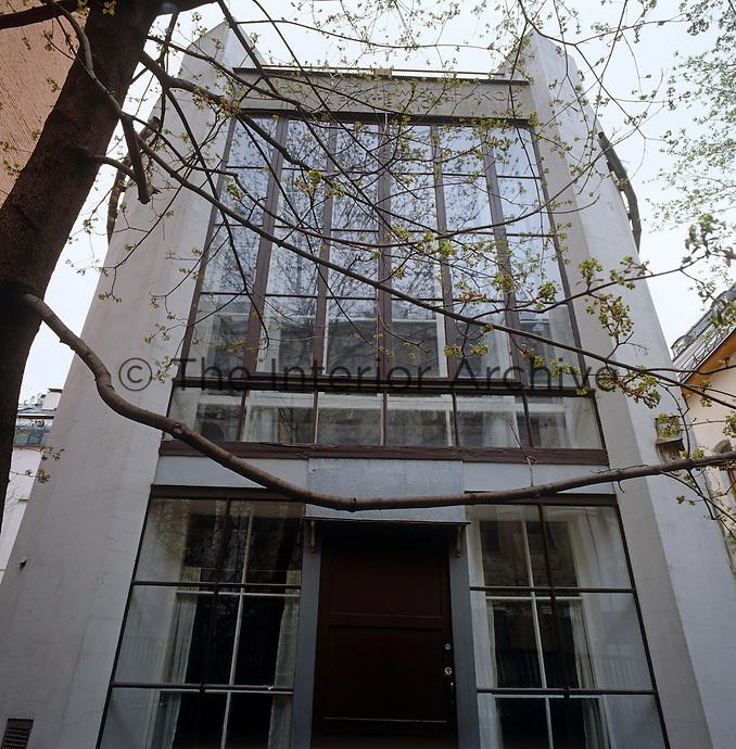 The full-length window of the simple yet grand Modernist facade of the Melnikov residence