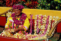 Dancer at Kodak Hula Show with flower leis