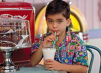 ITALIAN AMERICAN BOY (9) DRINKING MILK AT A SODA FOUNTAIN. ITALIAN-AMERICAN BOY (9). ORLANDO FLORIDA.