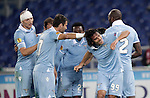 Calcio, Europa League: Lazio vs Panathinaikos. Roma, stadio Olimpico, 8 novembre 2012..Lazio forward Sergio Floccari, second from right, celebrates with teammates after scoring during the Europa League Group J football match between Lazio and Panathinaikos, at Rome's Olympic stadium, 8 november 2012..UPDATE IMAGES PRESS/Riccardo De Luca