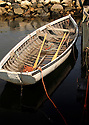 An old rowboat waits for its captain in the cold dark waters of Peggy's Cove, Nova Scotia.