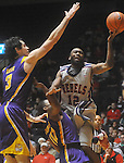 "Ole Miss guard Chris Warren (12)  is fouled by Louisiana State's Andre Stringer (10) as Louisiana State's Garrett Green (3) also defends at the C.M. ""Tad"" Smith Coliseum in Oxford, Miss. on Wednesday, February 9, 2011. Ole Miss won 66-60 and is now 4-5 in the Southeastern Conference."