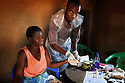EVERINE KHONDENI, 32, WHOSE HUSBAND IS POSITIVE, HAS AN AIDS TEST INI HER HOME IN THE VILLAGE OF KASARIKA, MALAWI, WITH TESTER DYTON CHINGANYAMA, 25. PART OF THE GOOD SAMARITAN PROJECT. PICTURE BY CLARE KENDALL. 5/11/12