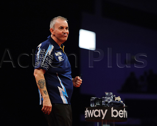 06.03.2014 Cardiff, Wales. Phil Taylor celebrates in his match against Robert Thornton which he wins 7-5 during Judgement Night of the Betway Premier League Darts at the Motorpoint Arena.
