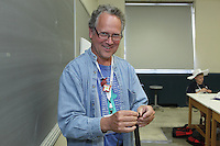 Scott Cramer teaches Flexicube by Philip Noble to a morning class at OrigamiUSA 2013.