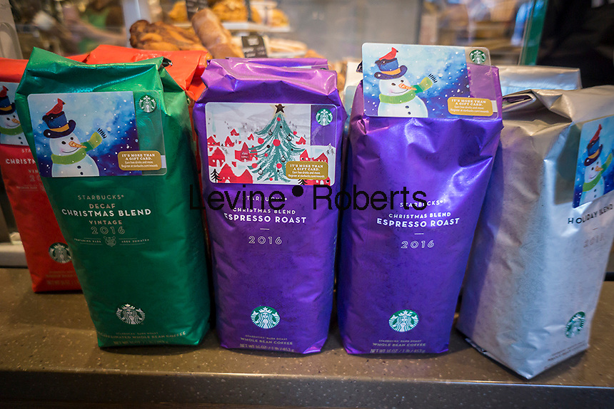 A display of Starbucks Christmas themed blends of coffee, complete with a gift card attached, in a store in New York on Tuesday, December 27, 2016. (© Richard B. Levine)