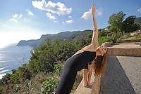 Yoga Shiromani Lena Tancredi, doing yoga in nature, in Ibiza, Spain - Photo by Nano Calvo