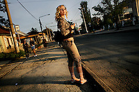 A young woman prepares to cross a street in Tiraspol, capital of Transnistria. Also known as Trans-Dniestr or Transdniestria, Transnistria, located mostly on a strip of land between the Dniester River and the eastern Moldovan border with Ukraine, broke away from Moldova in 1990 and although a de facto independent state, governed by the Pridnestrovian Moldavian Republic (PMR), is not recognised internationally.