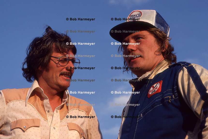 ROSSBURG, OH - OCTOBER 21: Ted Johnson, founder of the World of Outlaws auto racing series, and driver Steve Kinser meet after the event at Eldora Speedway near Rossburg, Ohio, on October 21, 1979.