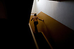 A boy runs up the stairs at a home for disturbed children operated by the NGO City Without Drugs in Yekaterinburg, Russia, on Monday, September 24, 2007. The program provides food, housing, and supervision for a dozen children who were either homeless or otherwise in a difficult situation. Homeless street children frequently turn to drugs and prostitution.