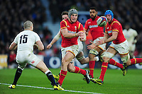Jonathan Davies of Wales passes the ball. RBS Six Nations match between England and Wales on March 12, 2016 at Twickenham Stadium in London, England. Photo by: Patrick Khachfe / Onside Images
