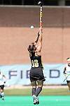 30 August 2014: Iowa's Jessy Silfer tries to knock the ball out of the air. The Wake Forest University Demon Deacons played the University of Iowa Hawkeyes at Francis E. Henry Stadium in Chapel Hill, North Carolina as part of the ACC/Big 10 Challenge and an 2014 NCAA Division I Field Hockey match. Iowa won the game 4-1.