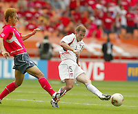 John O'Brien passes the ball. The USA tied South Korea, 1-1, during the FIFA World Cup 2002 in Daegu, Korea.