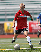 Aztec MA midfielder Clare Pleuler (11) passes the ball. In a Women's Premier Soccer League (WPSL) match, Aztec MA defeated CFC Passion, 4-0, at North Reading High School Stadium on July 1, 2012.