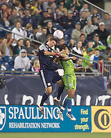 New England Revolution midfielder Chris Tierney (8) and Seattle Sounders forward David Estrada (16) battle for head ball. In a Major League Soccer (MLS) match, the Seattle Sounders FC defeated the New England Revolution, 2-1, at Gillette Stadium on October 1, 2011.