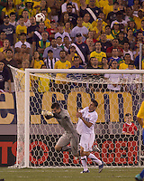 Brazil goalkeeper Victor (1) punches away US shot as USA forward Alejandro Bedoya (11) is involved.  Brazil  defeated the US men's national team, 2-0, in a friendly at Meadowlands Stadium on August 10, 2010.