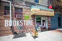 An unnamed multilingual, multicultural, ethnic bookstore in the Flatbush neighborhood of Brooklyn in New York features English, French, Spanish and Creole reading material, seen on Monday, July 7, 2014.  Few independent bookstores remain and the ones that are still in business tend to specialize in various subjects. (© Richard B. Levine)