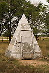Silver metal pyramid outhouse on the great plains of eastern Colorado