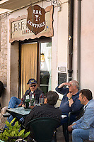 Abruzzo National Park, Italy, June 2008. Old men meet at the bar centrale.  The Medieval Village of Barrea with its narow winding streets overlooks the lake. Photo by Frits Meyst/Adventure4ever.com