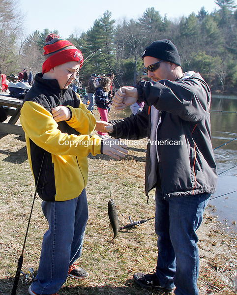 WATERTOWN, CT.- 19 APRIL 2014 - 041914JW03 - Andrew Cattaneo shows off the trout he caught to his father James Cattaneo of Waterown at Black Rock Lake Saturday morning during the Opening Day of Trout fishing.<br /> Jonathan Wilcox Republican-American