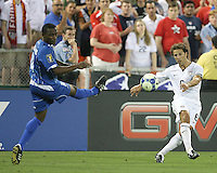 Steve Cherundolo #6 of the USA sends over a cross past Carlos Palacios #14 of Honduras during a CONCACAF Gold Cup match at RFK Stadium on July 8 2009 in Washington D.C. USA won the match 2-0.