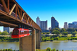 The Memphis Suspension Railway or Mud Island Monorail is a suspended monorail that connects downtown Memphis with the southern tip of Mud Island.  It sits beneath a footbridge over the Wolf River, a tributary of the Mississippi River.