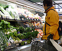 March 23, 2011, Tokorozawa, Japan - A Japanese consumer checks vegetables at a local supermarket in Tokorozawa, a western suburb of Tokyo, on Wednesday, March 23, 2011. Japanese Prime Minister Naoto Kan warned consumers against eating leaf vegetables such as spinach harvested in Fukushima prefecture, where crippled nuclear reactors are located, in the first measure to be taken since radioactive materials far exceeding legal limits were found in vegetables there. (Photo by Natsuki Sakai/AFLO) [3615] -mis-..