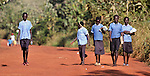 Children walking to school in the morning in Pisak, a village in Southern Sudan.