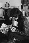 Patrick Procktor artist London 1969. Patrick with Gervase Griffiths who is reading a first copy of the Black Dwarf. Manchester Street flat. ( Picture used in Patrick Procktor Self-Portrait.