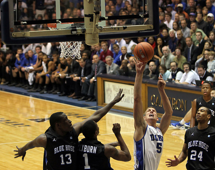 Mason Plumlee takes a shot. Duke beat Presbyterian 96-55 on Saturday, November 12, 2011 at Cameron Indoor Stadium in Durham, NC. It was win number 902 for Duke head coach Mike Krzyzewski, tying him with Bob Knight for the NCAA Division I all-time win record. Photo by Al Drago.