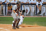 Mississippi's Tim Ferguson (4) scores vs. Arkansas-Little Rock's Landis Wilson at Oxford-University Stadium in Oxford, Miss. on Wednesday, April 7, 2010. Arkansas-Little Rock won 9-6.