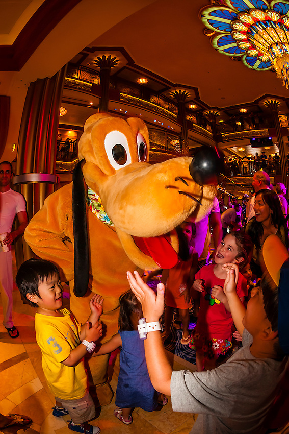 Pluto, Character dance party, in the lobby atrium on the new Disney Dream cruise ship sailing between Florida and the Bahamas.